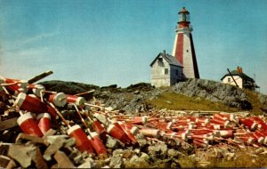 Canada Nova Scotia Yarmouth Lighthouse With Lobster Pot Markers In Foreground