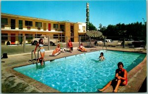 Fallon, Nevada Postcard TRAVELODGE MOTEL Girls at the Pool w/ Ford T-Bird c1960s