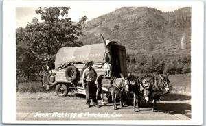 Pritchett, Colorado RPPC Photo Postcard Jack Ratliff Covered Wagon Burros 1940s