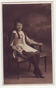 P719 old photo type young lady poses in chair
