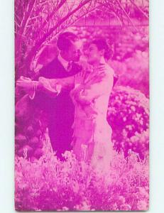 1935 foreign ROMANTIC FRENCH COUPLE ON PINK TINTED POSTCARD o7515