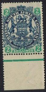 RHODESIA 1896 ARMS 2/-