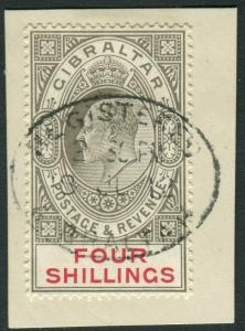 GIBRALTAR-1910 4/- Black & Carmine.  A fine used example on piece Sg 73