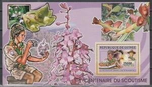 Guinea, 2006 issue. Centenary of Scouting. Boy Scout with Orchids s/sheet. #2  ^