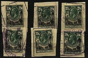 NORTHERN RHODESIA 1925 GV 2/6d SG12 x 6 fiscally used on pieces...........98524