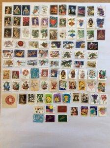 USA 100 stamps - Lot J