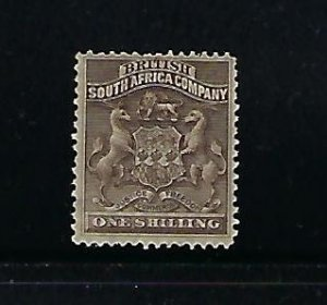 RHODESIA SCOTT #9 1890-95 COAT OF ARMS 1SH (GREY BROWN)  - MINT HINGED