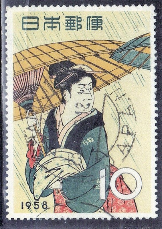 JAPAN SCOTT# 646  1958  10y  WOMAN WITH UMBRELLA   SEE SCAN