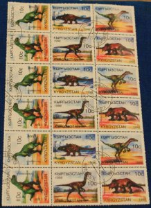 Kyrgyzstan block of 18 stamps cancelled first day #118 dinosaurs