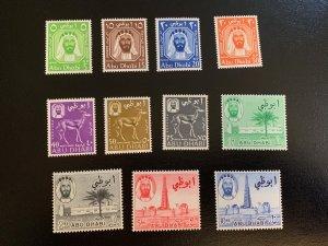 Abu Dhabi 1964 set, unused VLH.  Scott 1-11 CV $95.00. Michel 1-11  CV €110.00