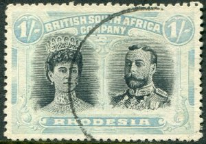 RHODESIA-1910-13 1/- Black & Pale Blue-Green Sg 152 FINE USED V48388