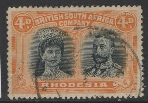 RHODESIA SG138 1910-3 4d GREENISH BLACK & ORANGE FINE USED