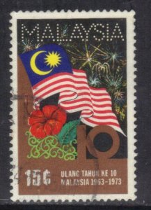 MALAYSIA SC# 104 **USED** 1973  15c  FLAG & FIREWORKS   SEE SCAN