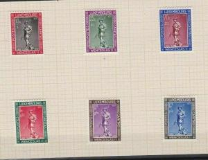LUXEMBOURG 1937 CHARITY STAMPS SET MOUNTED MINT ON PIECE  . REF R 2551