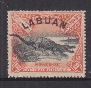 LABUAN, 1897 12c. Crocodile, perf. 14 1/2-15, heavy hinged mint.