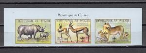 Guinea, 1999 issue. African Wild Animals, IMPERF strip of 3. Scout logo.