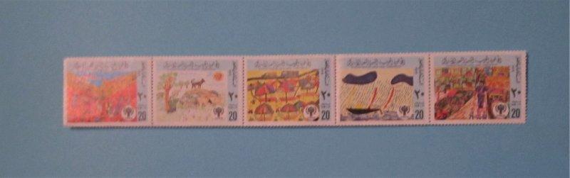 Libya - 810, MNH Strip Set. Child Drawings; IYC Emblem. SCV - $5.00