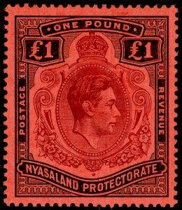 NYASALAND PROTECTORATE SG143, £1 purple & black/red, VLH MINT. Cat £50.