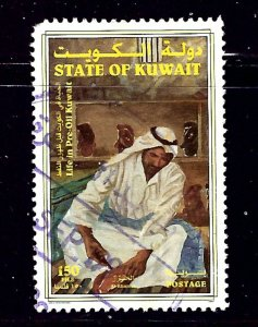 Kuwait 1415 Used 1998 Man Gluing Artifacts together  nibbed corner perf    (a...