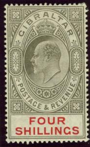 GIBRALTAR-1910 4/- Black & Carmine.  A lightly mounted mint example Sg 73