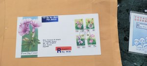 1991 SINGAPORE REGISTERED FDC TO ENGLAND  ON PHILANIPPON SINGAPORE FLORA STAMPS