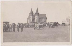 Post Card - Showing large gathering of early Automobiles at a Church