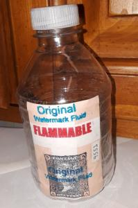 Original watermark Fluid huge 8 oz bottle with 50 world used stamps.