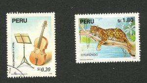 PERU-TWO USED STAMPS-FAUNA-WILD ANIMALS-VIOLIN - 1995.