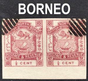North Borneo Scott 35a magenta  VF CTO imperforated pair. Genuine.