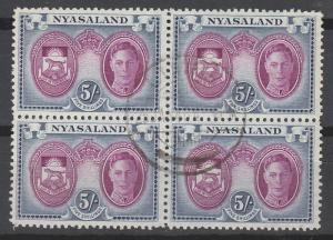 NYASALAND 1945 KGVI ARMS 5/- BLOCK USED