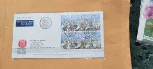 1986 SINGAPORE REGISTERED FDC TO ENGLAND  ON 25 COMMEMORATIVE STAMP ISSUE
