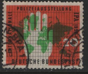 Germany 751, USED, 1956 Map of the world and policeman's hands