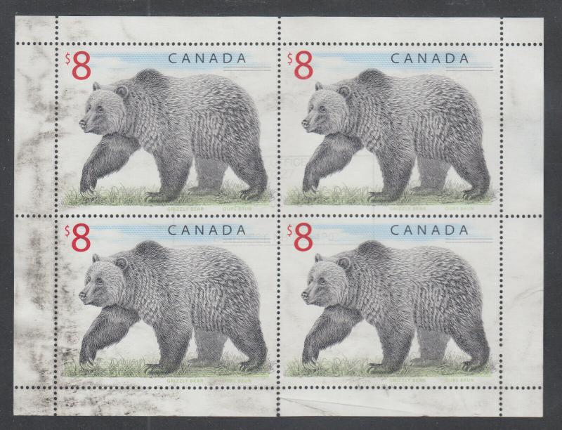 Canada Sc 1694 used. 1997 $8.00 Grizzly Bear, complete sheet of 4, margin fault