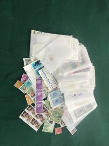 Bag of mystery stamps Hundreds of Mint singles, doubles, blocks and Plate Blocks