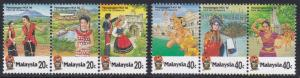 Malaysia #324-25 strips of 3, F-VF Mint NH Travel Conference