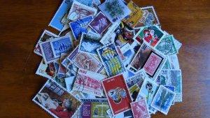 Worldwide stamp accumulation, kiloware ,1 oz around 450 off paper stamps, AC103