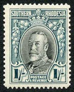 Southern Rhodesia SG23 1/- Black and Greenish Blue Perf 14 U/M (indentation at