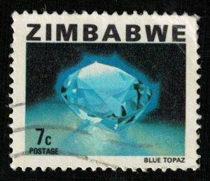 Blue Topaz, 7 cents (T-6098)