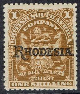 RHODESIA 1909 OVERPRINTED ARMS 1/-