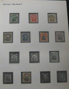 RHODESIA 1924-1977, in Tudor Hingeless album, used & mint, Scott $620.00