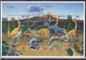 Bhutan, Scott cat. 1217 a-l. Prehistoric Animals sheet. ^
