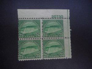 # 699 Mint NH Plate Block