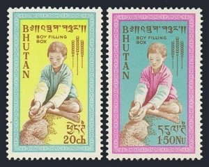 Bhutan 13-14 bl./4,MLH/MNH. FAO,Freedom from Hunger,1963.Boy filling grain box.