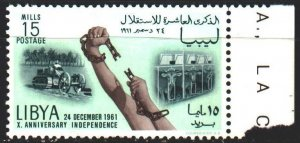 Libya. 1961. 112 from the series. 10 years of independence, hands are breakin...