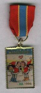 Denmark. Christmas Seal 1996 Walk Medal. Santa Kissing.