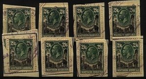 NORTHERN RHODESIA 1925 GV 2/6d SG12 x 8 fiscally used on pieces...........98523