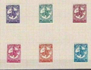 LUXEMBOURG 1934 CHARITY STAMPS SET MOUNTED MINT ON PIECE  . REF R 2547