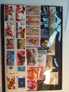 Lot 1 USA full page, 31 stamps used/unused