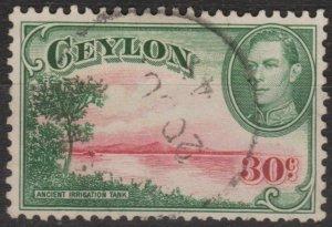 h034) Ceylon. 1938/49. Used.  SG 393a 30c Carmine & green. Royalty.