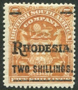 RHODESIA-1909-11 2/- on 5/- Orange Sg 118 MOUNTED MINT V48406